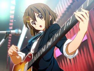 Rating: Safe Score: 63 Tags: blush brown_eyes brown_hair guitar hirasawa_yui instrument jpeg_artifacts k-on! microphone nyoronyoro school_uniform short_hair User: RyuZU