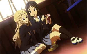Rating: Safe Score: 52 Tags: 2girls akiyama_mio black_eyes black_hair blonde_hair blue_eyes food k-on! kotobuki_tsumugi long_hair pocky scan seifuku User: meccrain