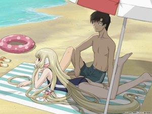 Rating: Safe Score: 19 Tags: beach blonde_hair chii chobits long_hair male motosuwa_hideki swim_ring swimsuit User: Oyashiro-sama