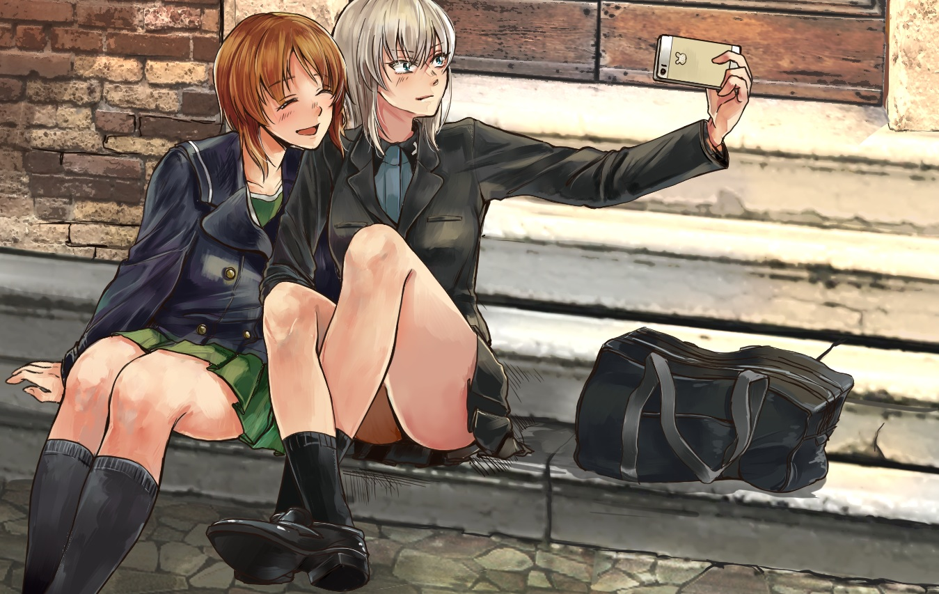 2girls blue_eyes brown_hair girls_und_panzer gray_hair itsumi_erika kani_aruki kneehighs long_hair nishizumi_miho phone school_uniform short_hair skirt socks